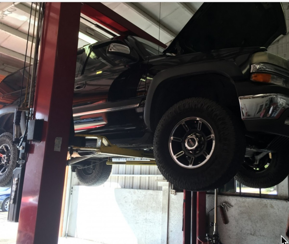 working on a truck on a lift